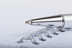 Ballpoint pen and notebook Royalty Free Stock Images