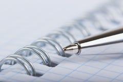 Ballpoint pen and notebook Stock Photos