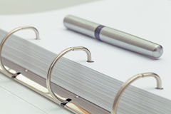 Ballpoint pen on notebook. office desktop detail. Stock Image