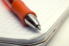 Ballpoint Pen On Notebook Stock Image