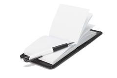 Ballpoint pen on open note pad Royalty Free Stock Photos