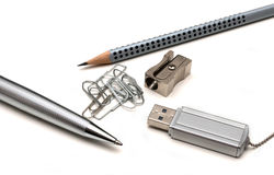 Ballpoint pen, pencil, paper clip, pencil sharpene Royalty Free Stock Images