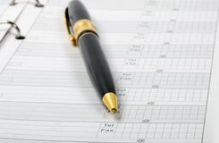 Ballpoint pen in phone book business. Background Stock Image