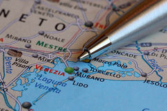 Ballpoint Pen Pointing at Venice on a Map of Italy Stock Images
