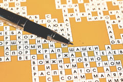 Ballpoint pen and rebus Royalty Free Stock Photos