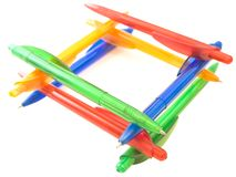 Ballpoint pens. Multicolored ballpoint pens in well form stock image