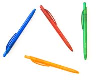 Ballpoint pens. Multicolored ballpoint pens against the white background stock photography