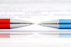 Ballpoint pens and document. Royalty Free Stock Photo