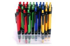Ballpoint pens in holders on white background. Stock Photo