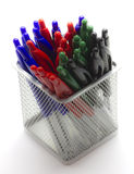 Ballpoint pens in a metal basket. Ballpoint pens in a square metal basket Royalty Free Stock Photo