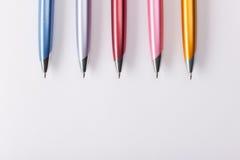 Ballpoint pens on table Stock Photo