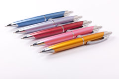 Ballpoint pens on table. Set up of ballpoint pens on table royalty free stock photography