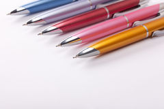 Ballpoint pens on table Stock Images