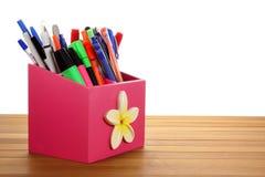 Ballpoint Pens. On Wooden Background stock image