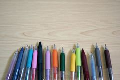 Ballpoint Pens on wooden table stock image