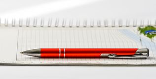 Ballpoint. The red ballpoint pen on a notebook stock images