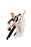 Ballrom dance couple in a dance pose isolated on white bachgroun Stock Photos