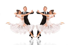 Ballrom dance couple in a dance pose isolated on white bachground Stock Photography
