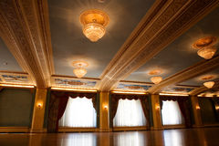 Ballroom. Grand, old fashioned ballroom with glass chandeliers Stock Photos