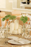 Ballroom. Candles and flowers on the table Stock Image