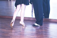 Ballroom dance dancers. Ballroom dance couple of dancers and teachers in studio school dancing in rehearsal Stock Images