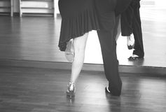 Ballroom dance dancers. Ballroom dance couple of dancers and teachers in studio school dancing in rehearsal Royalty Free Stock Image
