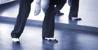 Ballroom dance dancers. Ballroom dance couple of dancers and teachers in studio school dancing in rehearsal Stock Image