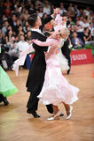 Ballroom dance couple, dancing at the competition. Stuttgart, Germany - August 16,2014: An unidentified dance couple in a dance pose during Grand Slam Standart stock image