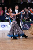 Ballroom dance couple, dancing at the competition. Stuttgart, Germany - August 16,2014: An unidentified dance couple in a dance pose during Grand Slam Standart royalty free stock photo