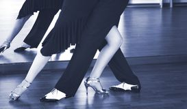 Ballroom dance dancers. Ballroom dance couple of dancers and teachers in studio school dancing in rehearsal Stock Photography