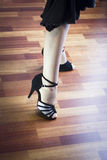 Ballroom dance latin dancer. Female ballroom, standard, sport dance, latin and salsa dancer feet and shoes in dance academy school rehearsal room dancing salsa Stock Photo