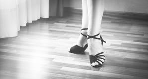 Ballroom dance latin dancer. Female ballroom, standard, sport dance, latin and salsa dancer feet and shoes in dance academy school rehearsal room dancing salsa Royalty Free Stock Images
