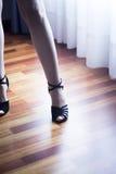 Ballroom dance latin dancer. Female ballroom, standard, sport dance, latin and salsa dancer feet and shoes in dance academy school rehearsal room dancing salsa Stock Images