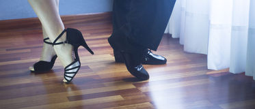 Ballroom dance latin dancers. Male and female ballroom, standard, sport dance, latin and salsa couple dancers feet and shoes in dance academy school rehearsal Stock Photo