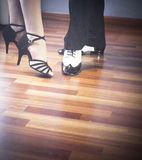 Ballroom dance latin dancers. Male and female ballroom, standard, sport dance, latin and salsa couple dancers feet and shoes in dance academy school rehearsal Royalty Free Stock Photography