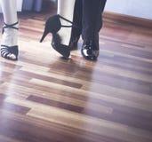 Ballroom dance latin dancers. Male and female ballroom, standard, sport dance, latin and salsa couple dancers feet and shoes in dance academy school rehearsal Stock Image