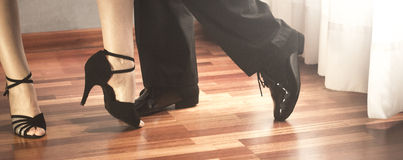 Ballroom dance latin dancers. Male and female ballroom, standard, sport dance, latin and salsa couple dancers feet and shoes in dance academy school rehearsal Royalty Free Stock Photos