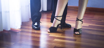 Ballroom dance latin dancers. Male and female ballroom, standard, sport dance, latin and salsa couple dancers feet and shoes in dance academy school rehearsal Royalty Free Stock Images