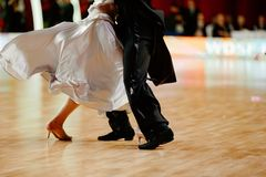 Ballroom dance partner dancers. In white dress and black suit tail stock photo