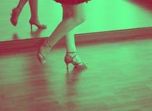 Ballroom dance salsa dancer. Female ballroom dance salsa dancer instructor woman dancing in shcool rehearsal room stock photo
