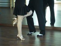 Ballroom dance salsa dancers. Ballroom dance salsa dancer instructors man and woman couple dancing in shcool rehearsal room Stock Photo