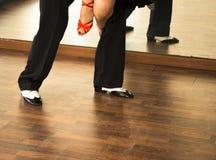 Ballroom dance salsa dancers. Ballroom dance salsa dancer instructors man and woman couple dancing in shcool rehearsal room Stock Photography
