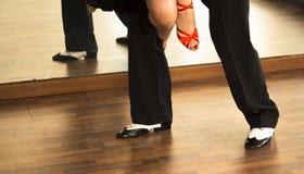 Ballroom dance salsa dancers. Ballroom dance salsa dancer instructors man and woman couple dancing in shcool rehearsal room Royalty Free Stock Images