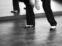 Ballroom dance salsa dancers. Ballroom dance salsa dancer instructors man and woman couple dancing in shcool rehearsal room Stock Images