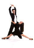 Ballroom Dancers Black 01. Young ballroom dancers in formal costumes posing against a solid background in a studio Stock Photo