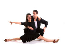 Ballroom Dancers Black 05. Young ballroom dancers in formal costumes posing against a solid background in a studio Royalty Free Stock Photo