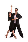 Ballroom Dancers Black 10. Young ballroom dancers in formal costumes posing against a solid background in a studio Royalty Free Stock Images