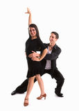 Ballroom Dancers Black 12. Young ballroom dancers in formal costumes posing against a solid background in a studio Stock Images