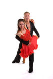 Ballroom Dancers Latin 05. Young ballroom dancers in formal costumes posing against a solid background in a studio Royalty Free Stock Photos