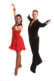 Ballroom Dancers Latin 09. Young ballroom dancers in formal costumes posing against a solid background in a studio Royalty Free Stock Photography